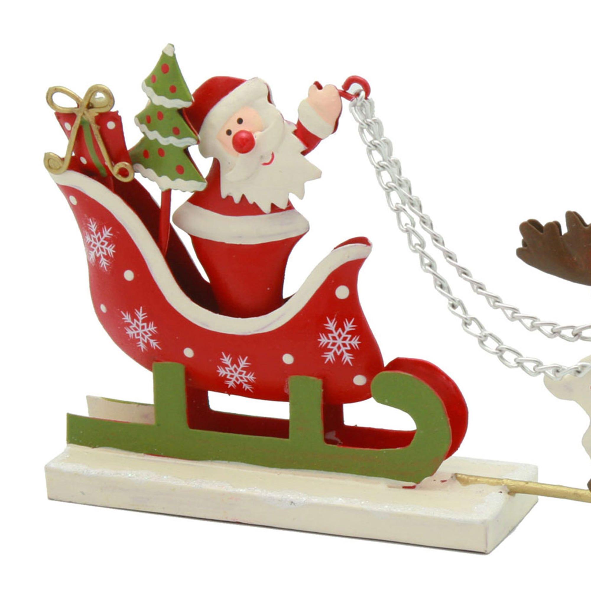 Santa Claus en trineo con renos
