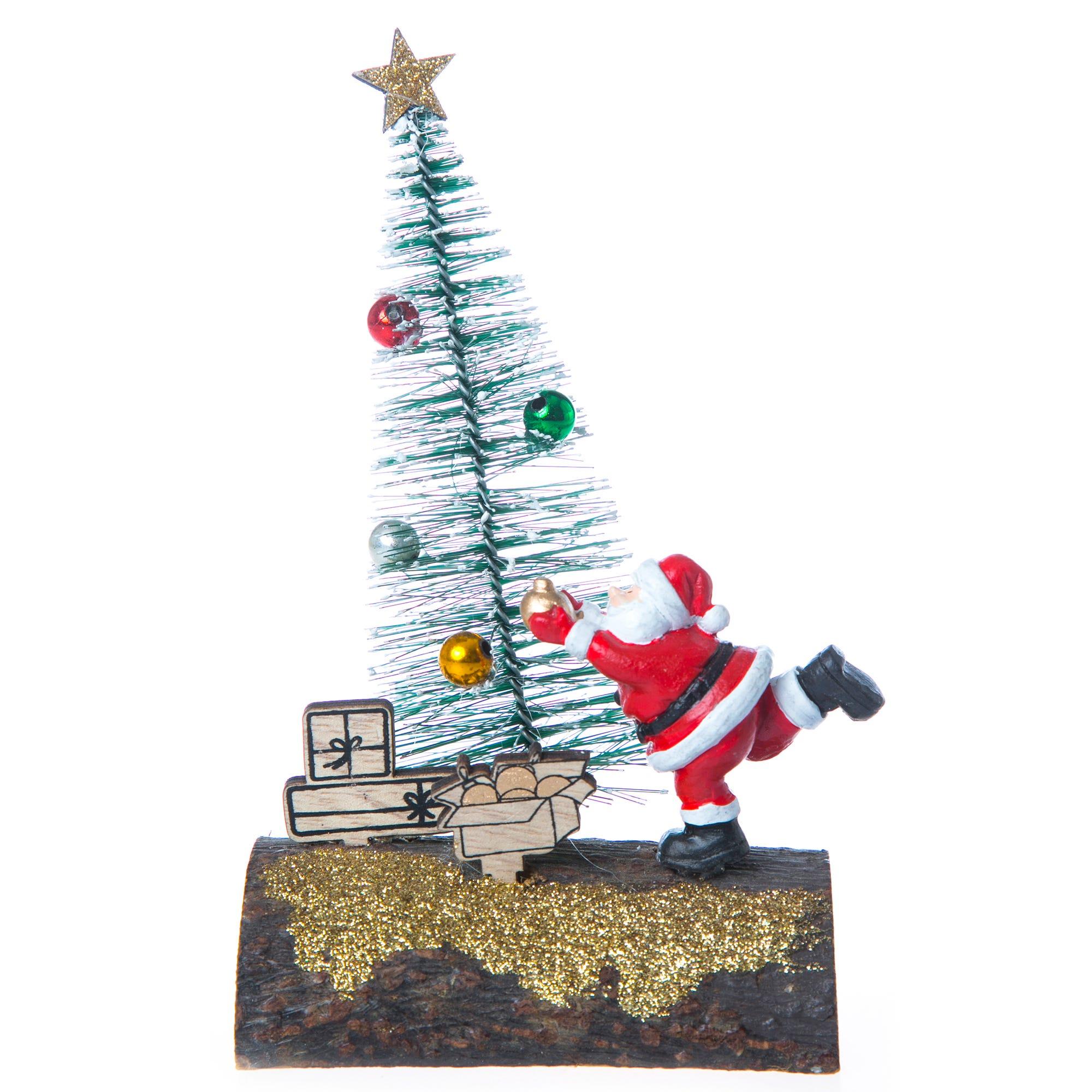 Santa Claus con árbol de Navidad