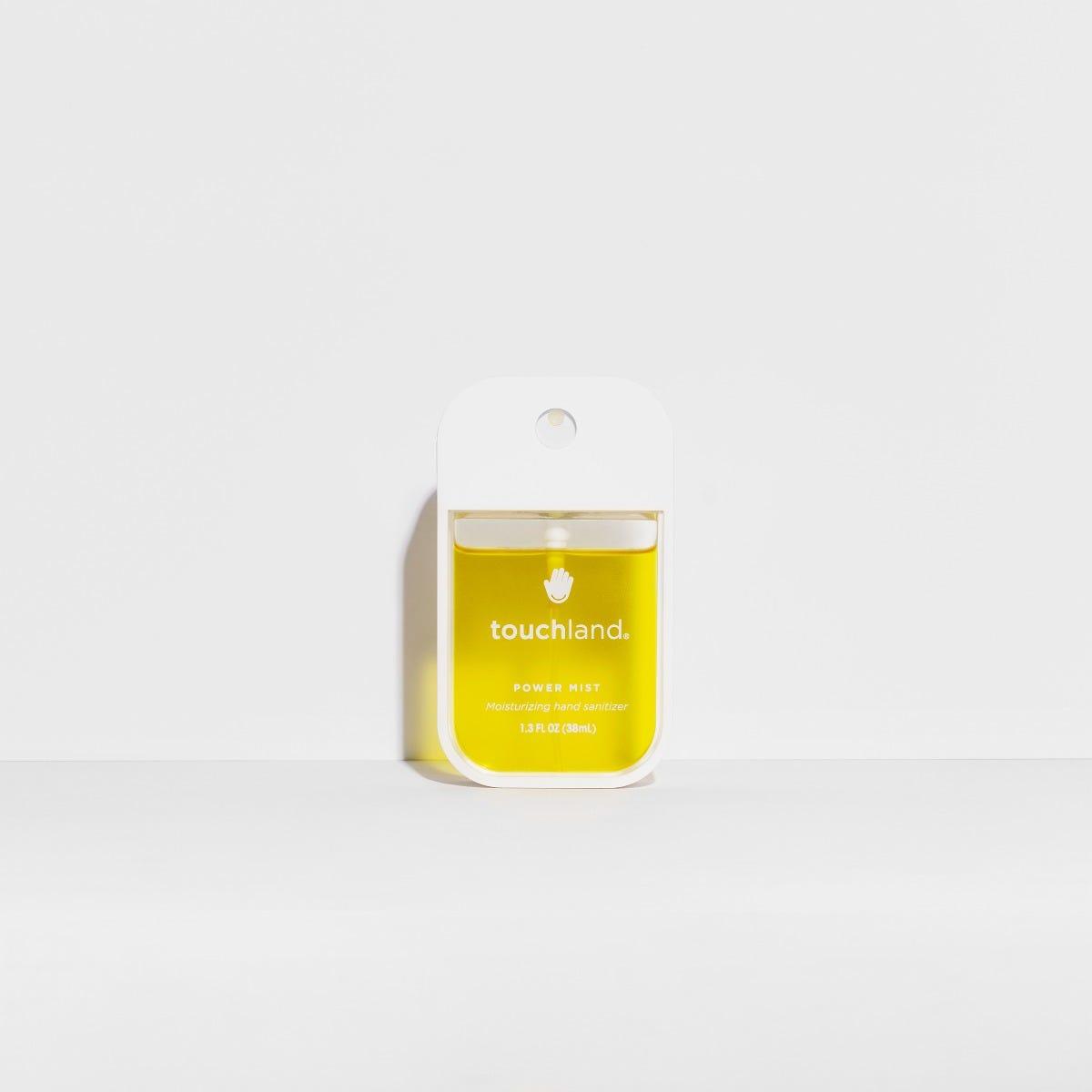 Spray antibacterial para manos Touchland aroma vainilla canela en amarillo